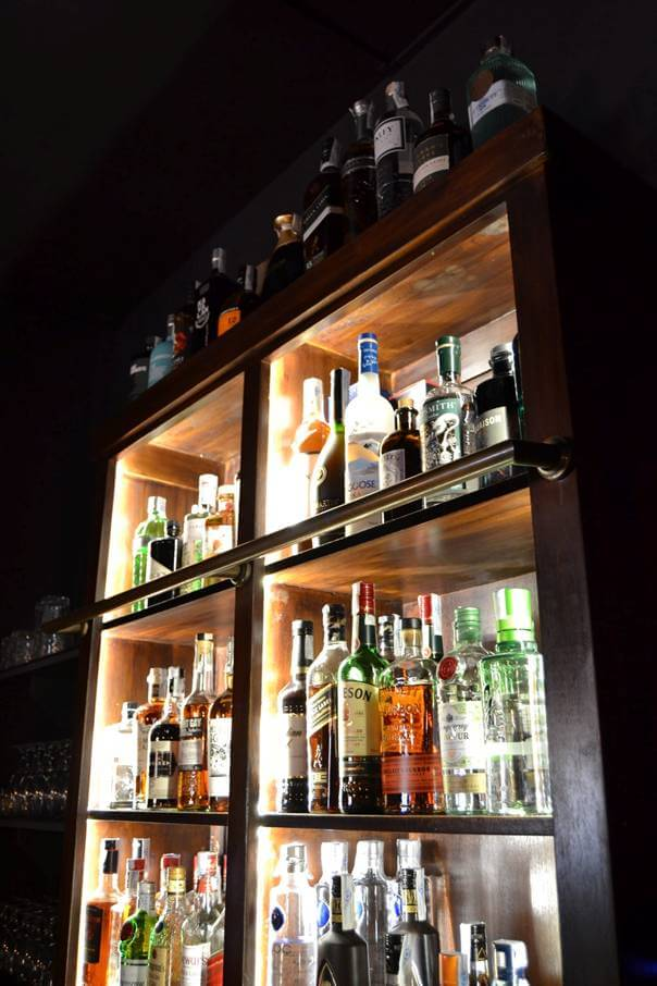A bar shelf lit up