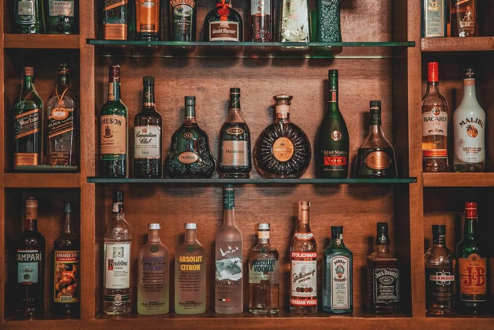 A wooden shelf full of bottles